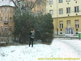 horny woman peeing into snow