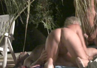 sexy mature in three-some next to the pool