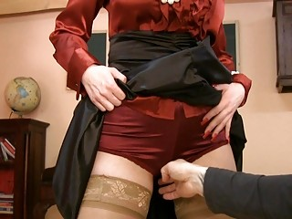 lady into glasses and satin pantyhose acquires