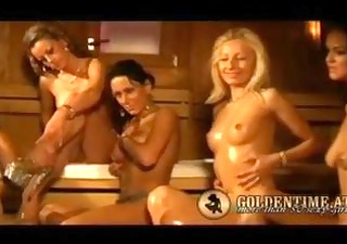 cuties making oil massage in the sauna