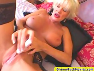 blonde grown-up masturbating with a lil device