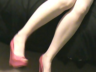 housewife inside a pink corset reddish stockings