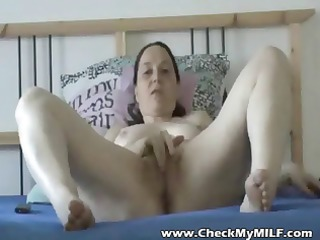 grown-up girl fingers and shoves a plastic cock