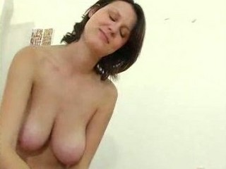 older  babe with giant boobs gives a handjob