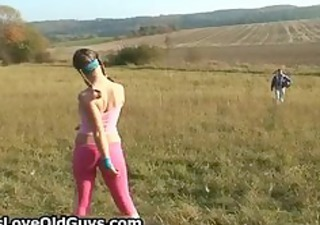 playful legal age teenager teasing an older man