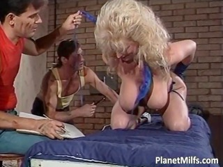 very lovely horny milf likes inside rubber
