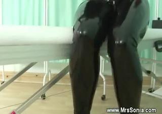 mature in latex sucks and bonks sex machine