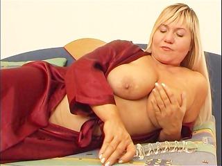 chubby lady masturbates with plastic cock