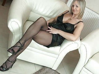 wonderful blond woman into stockings uncovers her