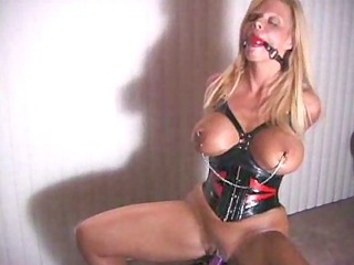 bound inside latex and humping the vibrator