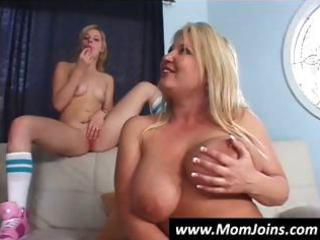 mother and daughter takes turns sucking on this